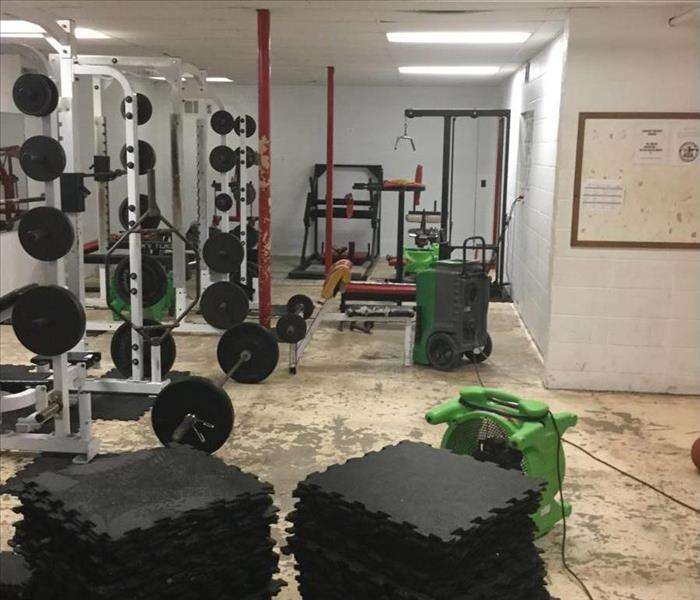 High school weight room after SERVPRO of Rolla has removed the mats and placed drying equipment